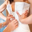 Buttoning  the  wedding dress — Stock Photo