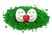 Two eggs on green stones. — Stock Photo