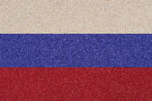 Russian flag made of colored decorative sand. — Stock Photo