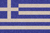 Greek flag made of colored decorative sand. — Stockfoto