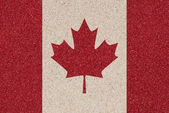 Canadian flag made of colored decorative sand. — Stock Photo