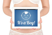 A pregnant woman is holding a tablet computer with the news about the child's gender boy. — Foto de Stock