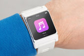 Close up white smart watch with music app icon on the screen — Stock Photo
