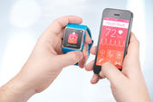 Data synchronization of health book between smartwatch and smart — Stock Photo