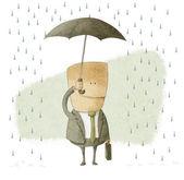 Happy businessman under an umbrella — Stock Photo