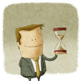 Man holding hourglass — Stockfoto