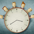 Business people on clock — Stock Photo