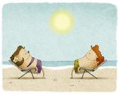 Couple sunbathing on deck chairs — Stock Photo