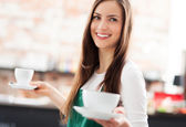 Waitress serving coffee — Stock Photo