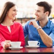 Stock Photo: young couple at cafe