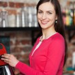 Female barista making coffee — Stock Photo