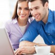 Young couple using laptop — Foto de Stock