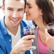 Young couple drinking wine — ストック写真