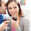 Young couple drinking wine — Stock fotografie
