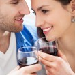 Foto Stock: Young couple drinking wine