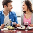 Couple having meal in restaurant — Stock Photo #23642471