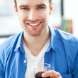 Stock Photo: Mhaving glass of wine
