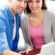 Stock Photo: Young couple using laptop