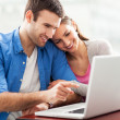 Young couple using laptop — Stock Photo #23643189