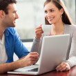 Young couple using laptop — Stock Photo #23643223
