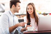 Young business using laptop at cafe — Stock Photo