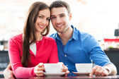 Young couple at cafe — Stock Photo