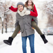 Couple having fun on winter day — Stock Photo