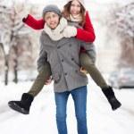 Couple having fun on winter day — Stock Photo