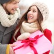 Man giving woman a surprise gift — Stock Photo #23672203
