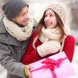 Man giving woman a surprise gift — Stock Photo
