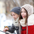 Winter couple with digital tablet — Stock Photo