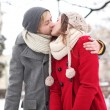 Couple kissing on winter day — Stock Photo #23672421