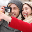 Couple with vintage camera — Stock Photo