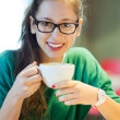 Female student with books and cup of coffee — Stock Photo