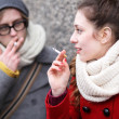 Stock Photo: Young couple smoking