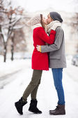 Couple kissing on winter day — Stok fotoğraf