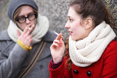 Young couple smoking — Stock Photo