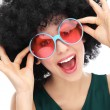 Woman with black afro and sunglasses - Stock Photo