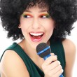 Womwith afro hairstyle doing karaoke — Stock Photo #23689963