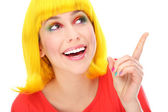 Yellow hair woman pointing up — Stock Photo