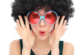 Woman with black afro and sunglasses — Stockfoto