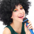 Stock Photo: Woman with afro hairstyle doing karaoke