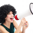 Woman shouting through megaphone — Stock Photo #23690129