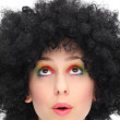 Excited woman wearing afro wig — Stock Photo
