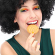 Funky woman eating cookie - Stock Photo