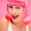 Beautiful young woman with pink hair — Stock Photo