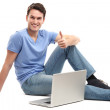 Young man with laptop — Stock Photo #23697527