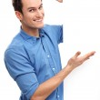 Casual young guy with blank board — Stock Photo