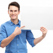 Casual young guy with blank board — Stock Photo #23698045