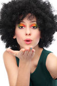 Woman with afro blowing a kiss — Stock Photo